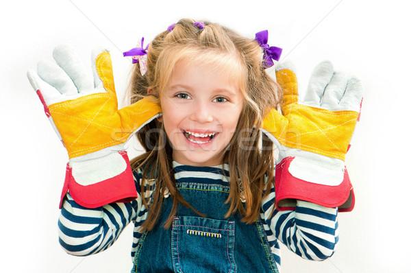 smiling girl with gloves Stock photo © GekaSkr