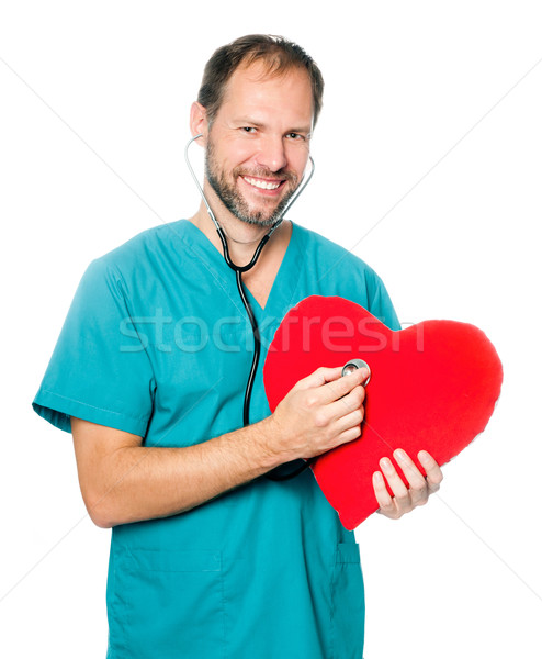 doctor examining a red heart Stock photo © GekaSkr