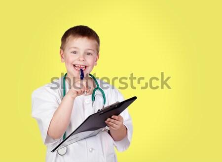 задумчивый ребенка врач равномерный изолированный белый Сток-фото © Gelpi