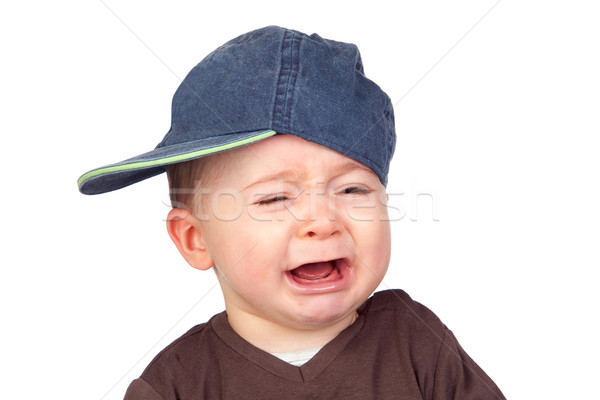 Beautiful baby crying with a cap Stock photo © Gelpi