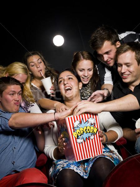 People eating popcorn Stock photo © gemenacom