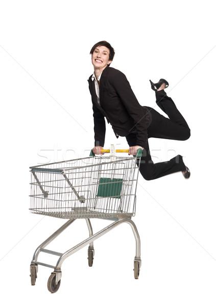 Jumping woman with a shopping cart Stock photo © gemenacom