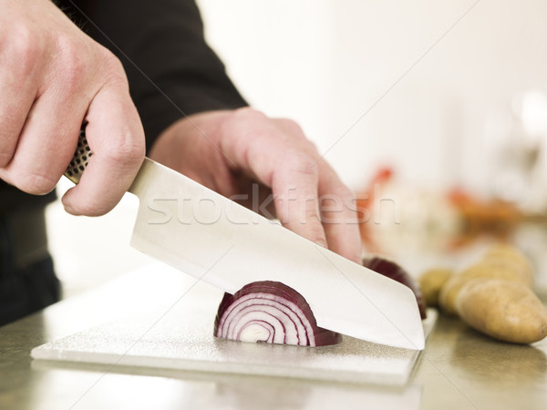 Cutting onion with a knife Stock photo © gemenacom