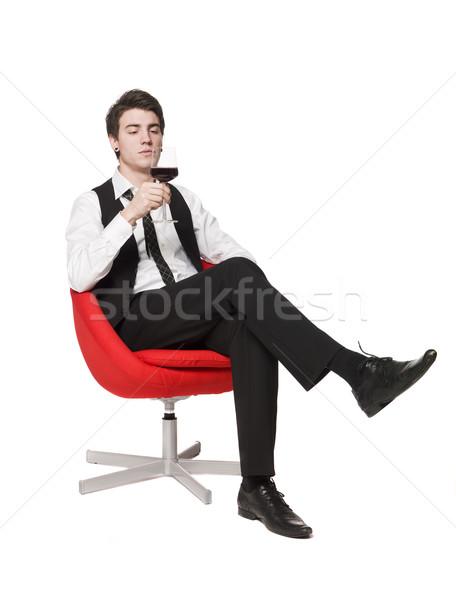 Man in a armchair drinking wine Stock photo © gemenacom