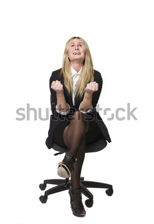Woman looking happy in a office chair Stock photo © gemenacom
