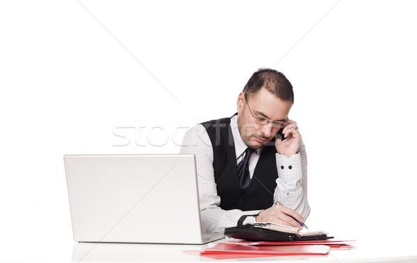 Férfi mögött asztal szervez nap számítógép Stock fotó © gemenacom