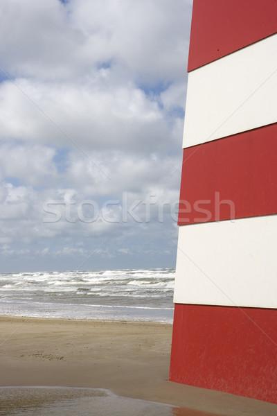 Mojón rojo blanco playa cielo mar Foto stock © gemenacom