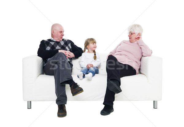 Lány nagyszülők kislány kanapé izolált fehér Stock fotó © gemenacom
