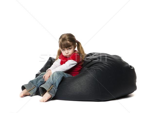 Little girl sessão saco de feijão criança triste diversão Foto stock © gemenacom