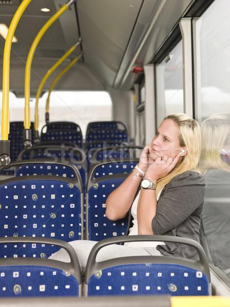 Ouvir música mulher jovem sozinho ônibus janela Foto stock © gemenacom