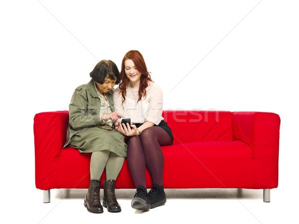 Pár telefon fiatal nő segít nagymama mobiltelefon Stock fotó © gemenacom