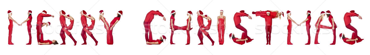Group of red dressed people forming the phrase 'Merry Christmas' Stock photo © gemenacom