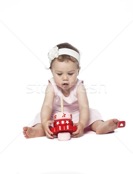 ребенка розовый одежды играет красный игрушку Сток-фото © gemenacom