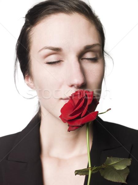 Woman smells a rose Stock photo © gemenacom