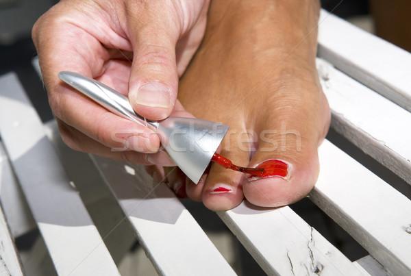 Painting toe nails Stock photo © gemenacom