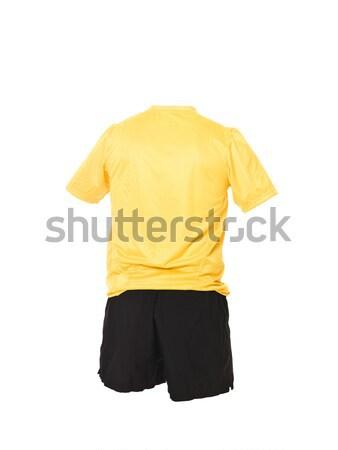 Yellow football shirt with black shorts Stock photo © gemenacom