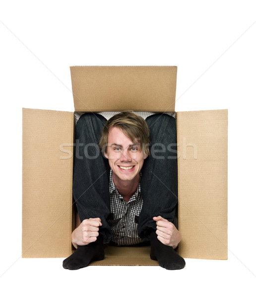 Acrobat inside of a cardboard box. Stock photo © gemenacom