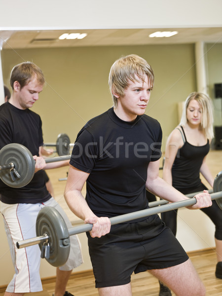 Group of people lifting weights Stock photo © gemenacom