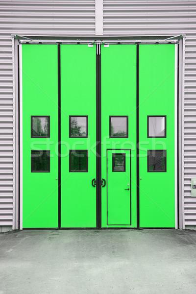 Green Garage Door on a warehouse building Stock photo © gemenacom