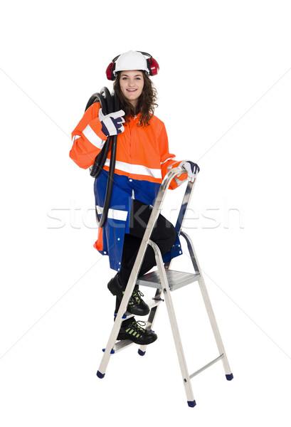 Vrouwelijke bouwvakker klimmen stap ladder geïsoleerd Stockfoto © gemenacom