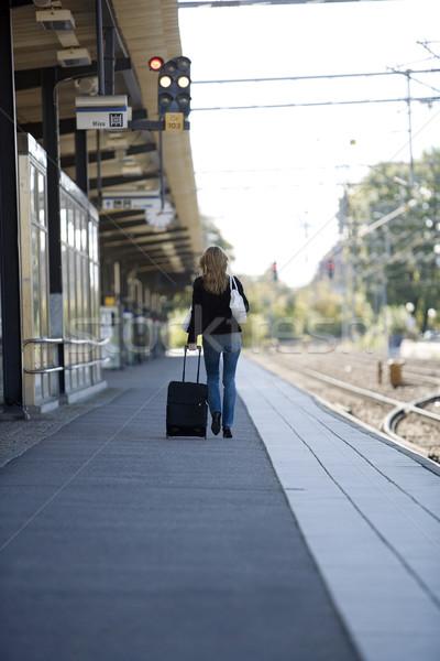 Utazás nő vasútállomás vonat utazás idő Stock fotó © gemenacom