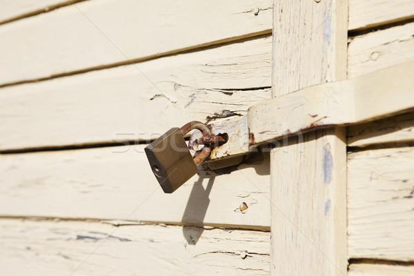 Lock on a worn door Stock photo © gemenacom