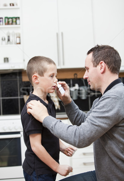 Father giving son Nose Drops Stock photo © gemenacom