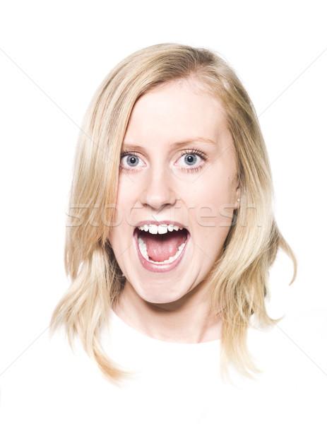 Lány készít vicces arc izolált fehér nő Stock fotó © gemenacom