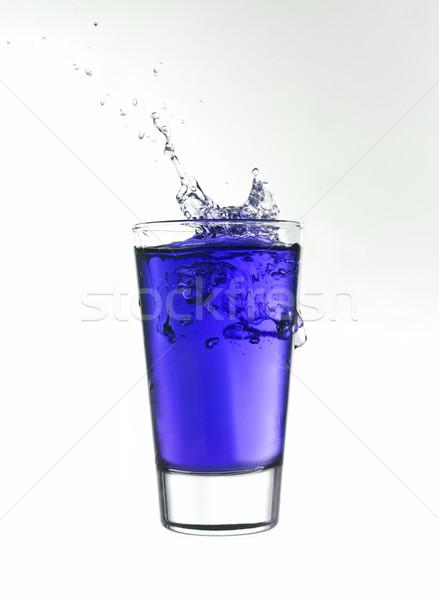 Csobbanás üveg kék limonádé izolált fehér Stock fotó © gemenacom