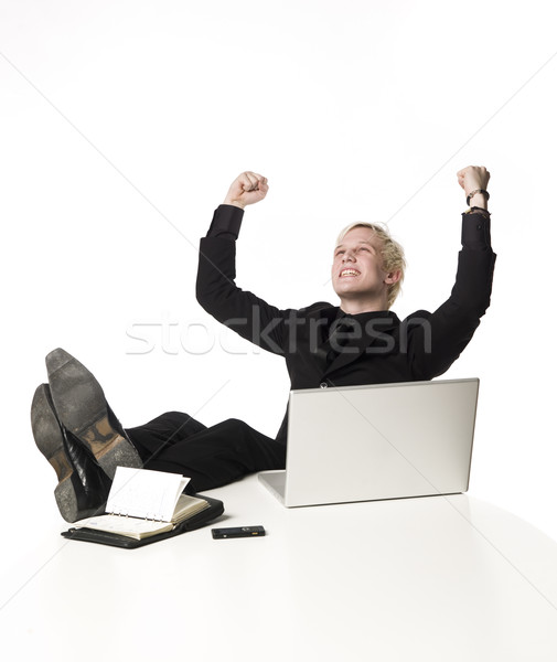 Happy boy siting infront of a computer Stock photo © gemenacom