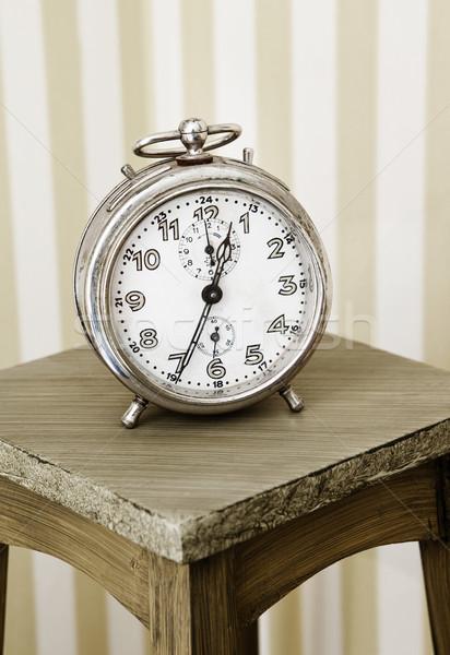 Alarm clock on a table Stock photo © gemenacom
