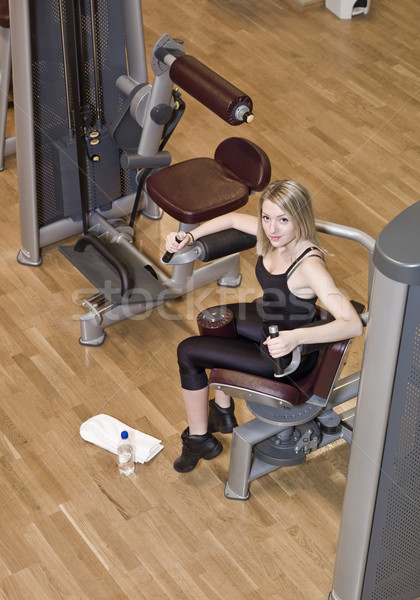 Boy and a girl using excercise machines Stock photo © gemenacom