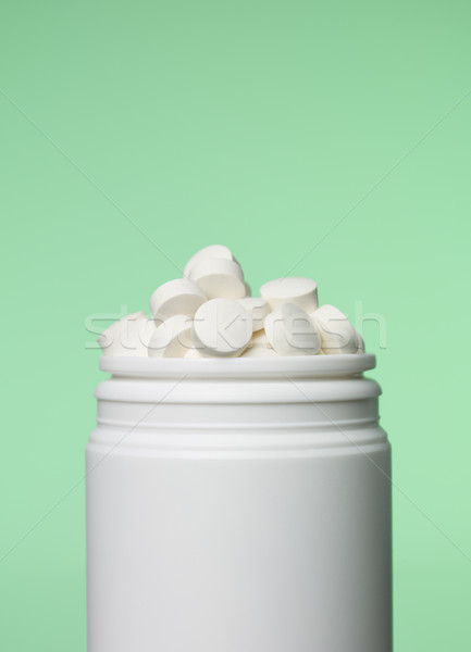 Can of pills toward green background Stock photo © gemenacom
