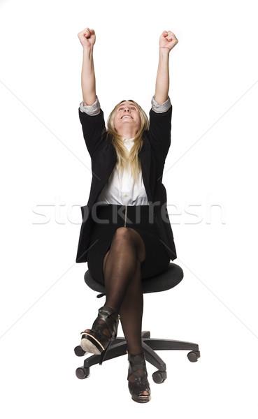 Woman rising her hands in the air Stock photo © gemenacom