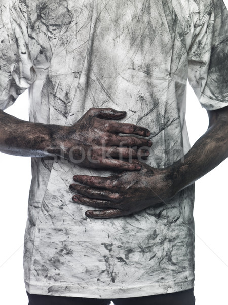 Dirty hands in front of a dirty shirt Stock photo © gemenacom