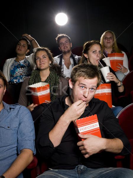 Człowiek kina popcorn młody człowiek film teatr Zdjęcia stock © gemenacom