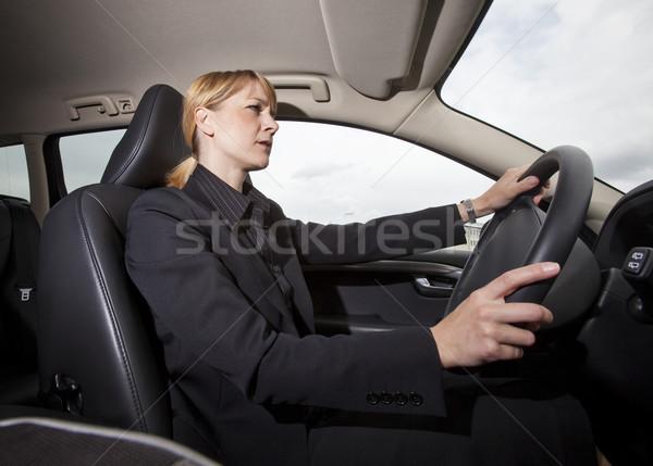Stockfoto: Vrouw · rijden · auto · verkeer · vrouwelijke · glimlachend