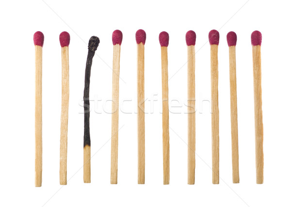 Matches on a row with one burned down. Stock photo © gemenacom