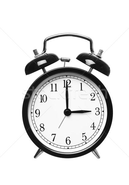 Alarm clock shows Three o`clock Stock photo © gemenacom