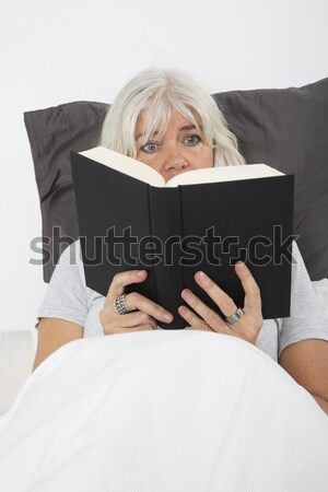 Laughing Young Girl Reading a book Stock photo © gemenacom