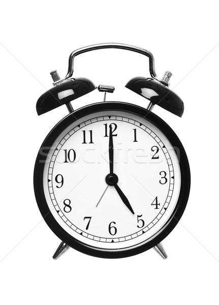 Alarm clock shows five o`clock Stock photo © gemenacom