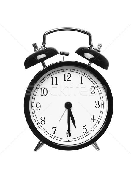 Mitad pasado cinco despertador aislado blanco Foto stock © gemenacom