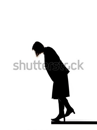 Silhouette of a woman looking down Stock photo © gemenacom