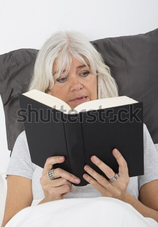 Reading a nail-biting book Stock photo © gemenacom