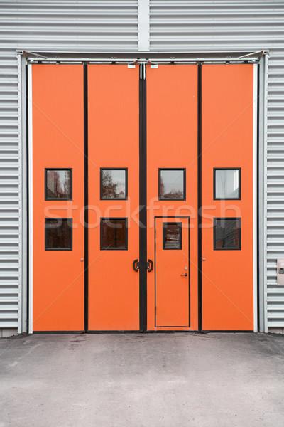 Orange Garage Door on a warehouse building Stock photo © gemenacom