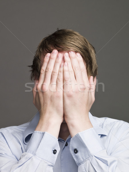 Man with his hands in over his face Stock photo © gemenacom