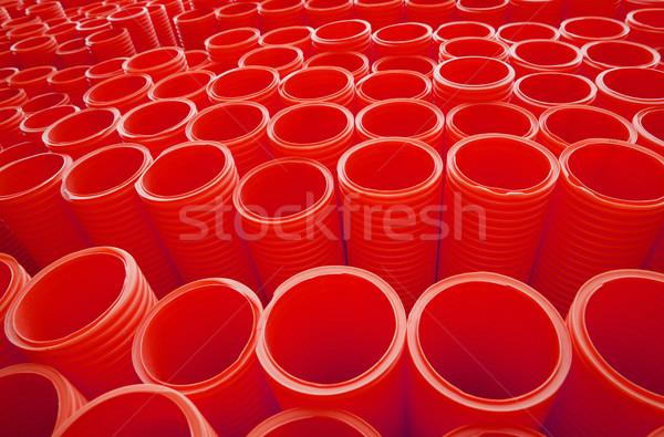 Büyük bir grup kırmızı endüstriyel plastik borular tam kare Stok fotoğraf © gemenacom
