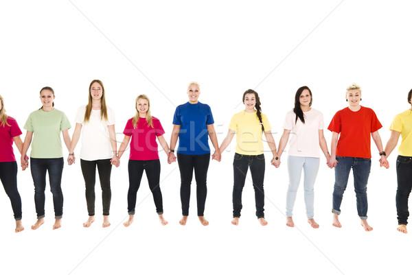 Strony dziewcząt kolorowy trzymając się za ręce odizolowany Zdjęcia stock © gemenacom