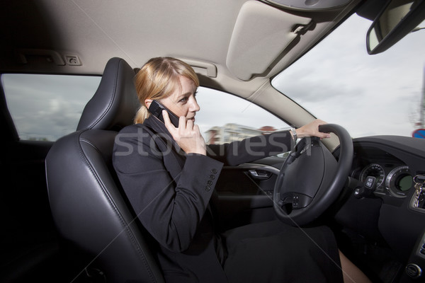 Woman on the phone when she driving her car Stock photo © gemenacom