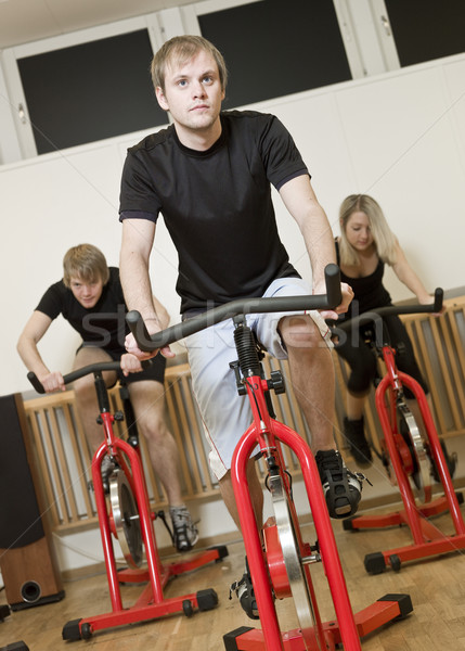 Group of people having spinning class Stock photo © gemenacom